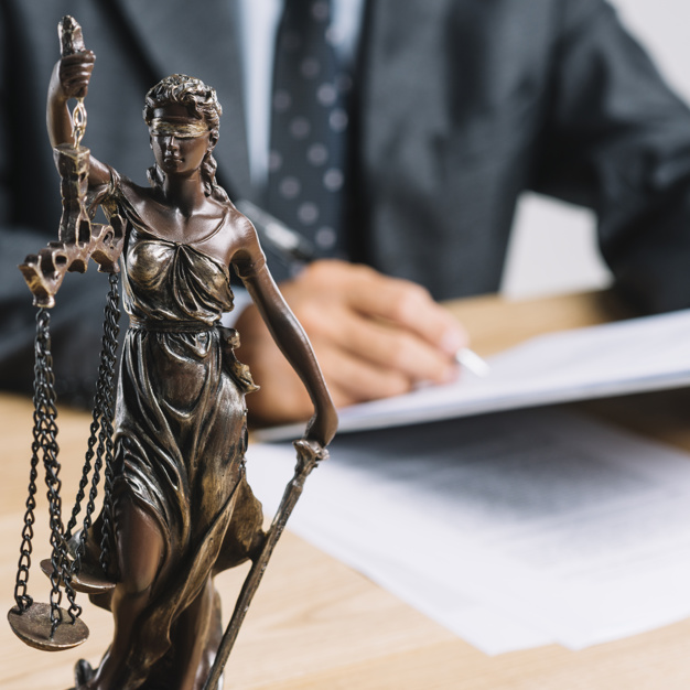 Close up themis lady justice holding scale front lawyer working desk 23 2147898349