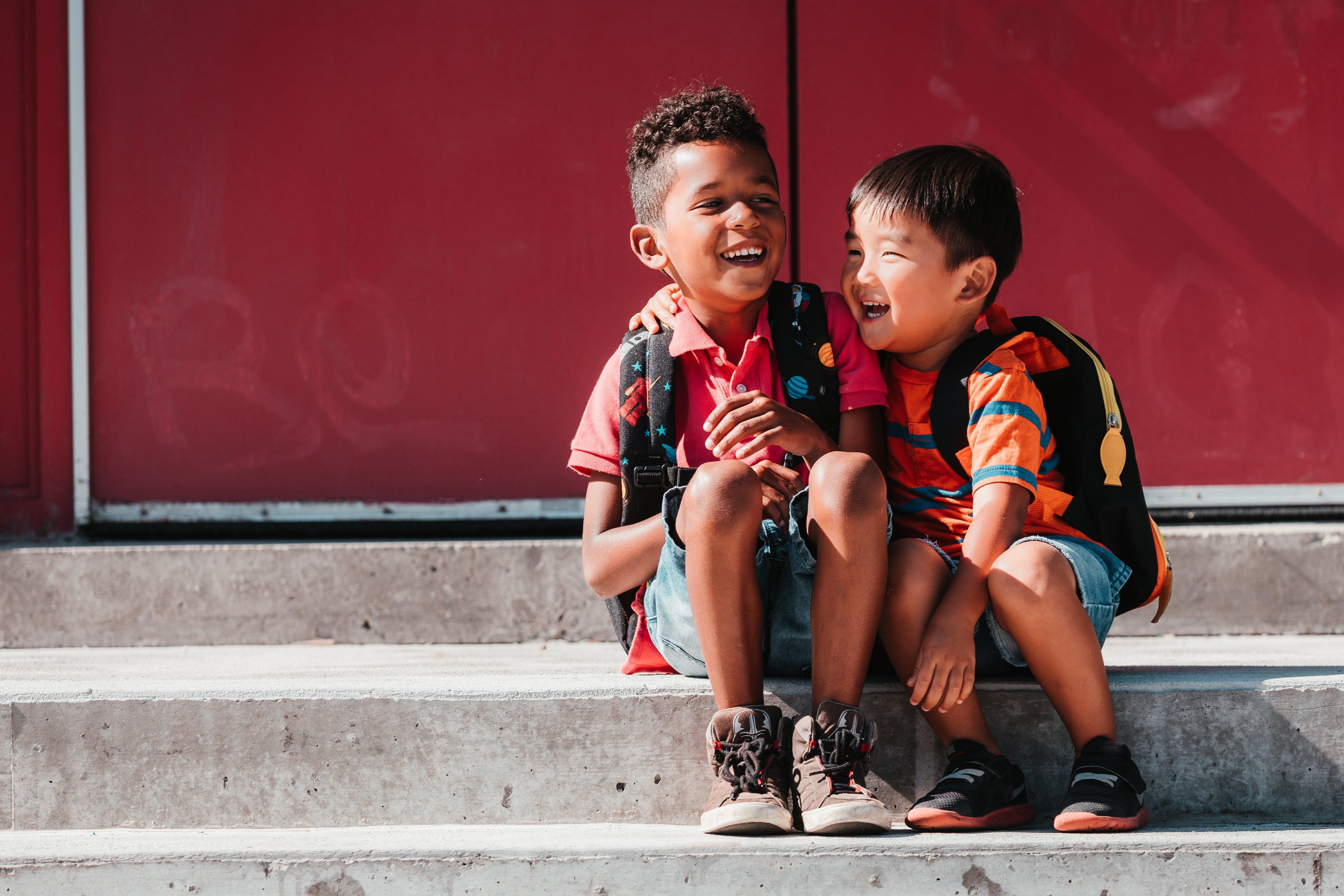 Kids giggle on steps