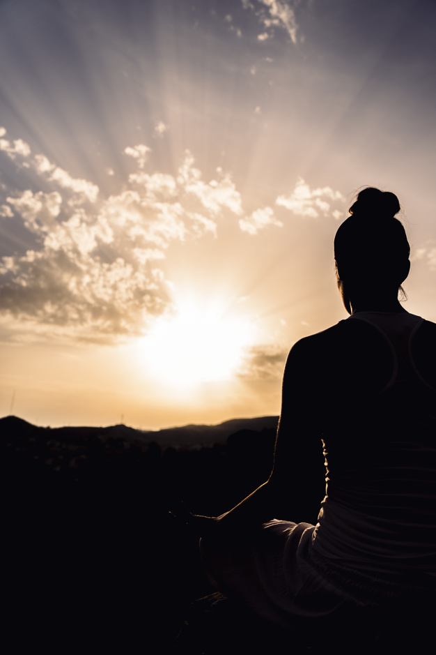 Woman during meditation with the sunset 23 2147658189